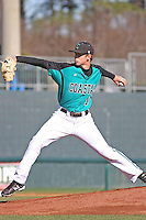 Coastal Carolina Chanticleers pitcher Ben Smith #11 pitching during a game against the North Carolina State Wolfpack at BB&T Coastal Field on February 26, 2012 in Myrtle Beach, SC.  Coastal Carolina defeated N.C. State 3-2. (Robert Gurganus/Four Seam Images)