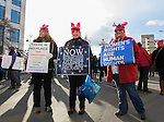 Lisa Droege, Cindy Norris and Cat Gowen, from Carson, get ready to lead the Reno Women's March on Washington event on Virginia Street in downtown Reno on Saturday, Jan. 21, 2017.