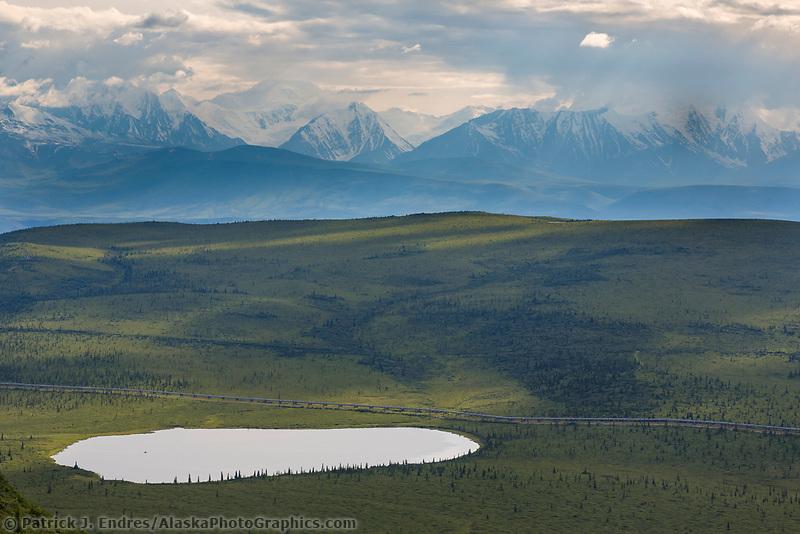 Trans Alaska oil pipeline transects the tundra in the Alaska Range.