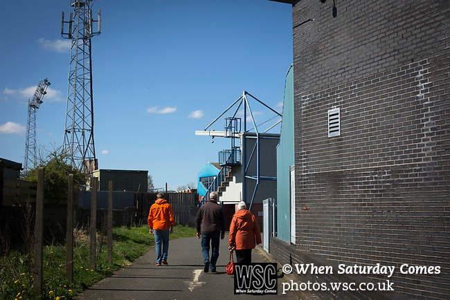 Away fans making their way to the turnstiles outside Palmerston Park, Dumfries before Queen of the South hosted Dundee United in a Scottish Championship fixture. The home has played at the same ground since its formation in 1919. Queens won the match 3-0 watched by a crowd of 1,531 spectators.