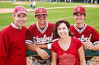 HOUSTON, TEXAS-Feb. 20, 2011:  Kenny and Danny Diekroeger of Stanford greet their parents, Ken and Kathy Diekroeger, following their game against Rice, in Houston, Texas.  Stanford defeated Rice 6-2.