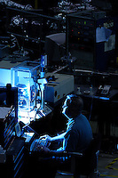 Associate researcher Bob Julian uses infrared light to study altered protein structures in human brain tissue damaged by Alzheimer's disease. Researchers at the UW Synchrotron Radiation Center in Stoughton, Wis., use a particle accelerator the size of a baseball diamond to conduct experiments on a wide array of topics, including quantum physics, superconductivity, nanotechnology and geology.<br /> <br /> Client: University of Wisconsin-Madison<br /> &copy; UW-Madison University Communications 608-262-0067<br /> Photo by: Michael Forster Rothbart<br /> Date: 7/06    File#:  D100 digital camera frame 10059.