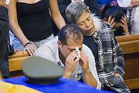 The Relatives of the Colombian policeman Juan Rodriguez, cry during his burial in the church of the town of Guarne. Darío Rodríguez died together with three soldiers in a clash with the Revolutionary Forces of Colombia (FARC) last April 29, 2012, the patrol was an ambush in the province Caqueta, in this procession there was travelling the French journalist Romeo Langlois, who is missing and apparently it has been kidnapped by the FARC. In province of Guarne, Antioquia, Colombia. 30/04/2012. Photo by Fredy Amariles/VIEWpress.