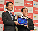 November 1, 2012, Tokyo, Japan : Yasuyuki Higuchi(L), President of Microsoft Co. Ltd., Japan and Kaoru Kato , President of NTT Docomo, Inc. attend a joint press conference in Tokyo, Japan, on November 1, 2012.