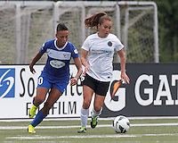 Portland Thorns FC midfielder Meleana Shim (6) brings the ball forward as Boston Breakers forward Lianne Sanderson (10) pressures. In a National Women's Soccer League (NWSL) match, Portland Thorns FC (white/black) defeated Boston Breakers (blue), 2-1, at Dilboy Stadium on July 21, 2013.