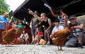 04/08/19<br /> <br /> 'Eggs'it that way - Competitors give frantic directions to their chickens on the start line.<br /> <br /> Hundreds of spectators watch as competitors race their hens at the World Championship Hen Racing on a purpose-built track outside the Barley Mow pub in Bonsall, in the Derbyshire Peak District.<br />  <br /> All Rights Reserved, F Stop Press Ltd +44 (0)7765 242650 www.fstoppress.com rod@fstoppress.com