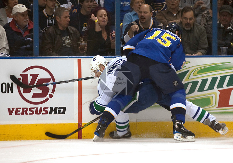 April 19 2009         Blues player Brad Winchester (15, right) smashes Canucks player Pavol Demitra (38) into the boards in the first period.  The St. Louis Blues hosted the Vancouver Canucks in the third playoff game between the two teams on Sunday April 19, 2009 at the Scottrade Center in downtown St. Louis, MO.  The Blues entered the game down 2-0 in the best of seven series.  ..            *******EDITORIAL USE ONLY*******