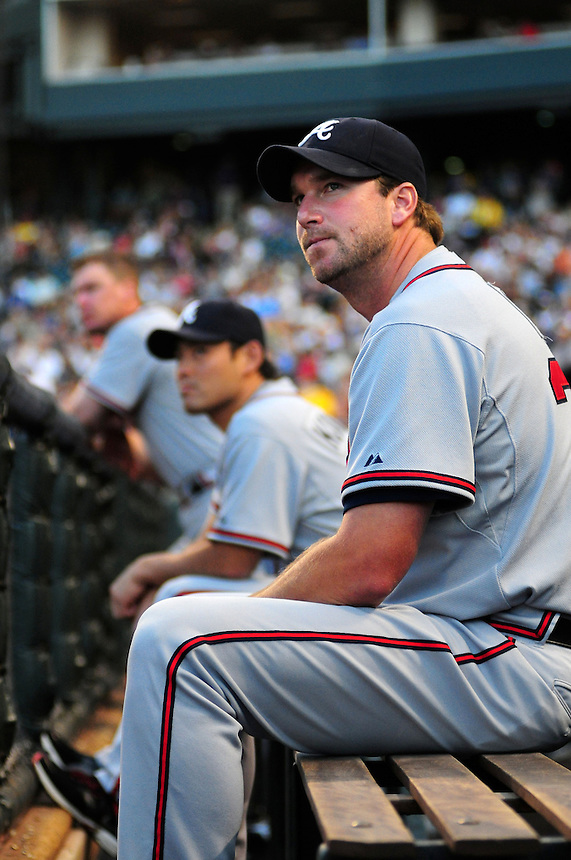 July 9, 2009: Braves pitcher Derek Lowe watches the game from the dugout during a regular season game between the Atlanta Braves and the Colorado Rockies at Coors Field in Denver, Colorado.