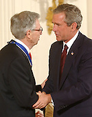 United States President George W. Bush honors Fred Rogers with the Presidential Medal of Freedom during a ceremony in the East Room of the White House in Washington, DC on 9 July, 2002.<br /> Credit: Ron Sachs / CNP