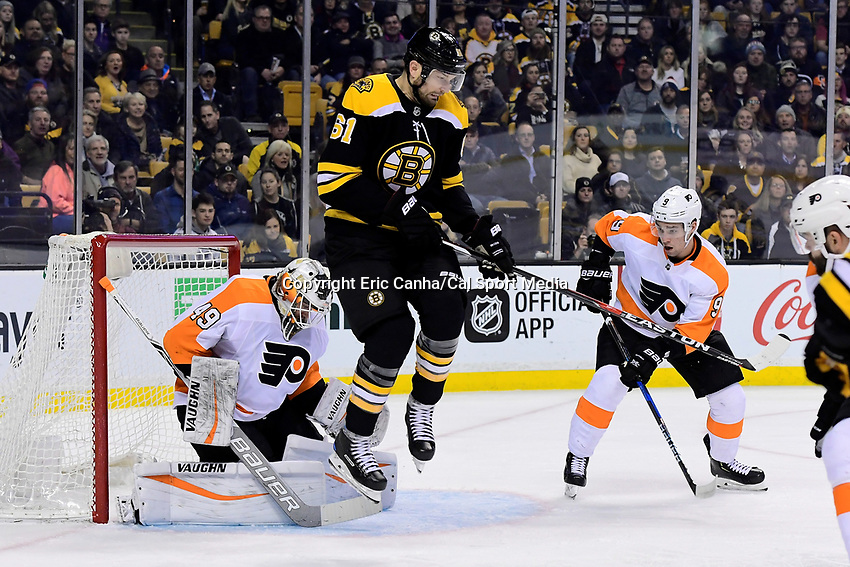 March 8, 2018: Boston Bruins left wing Rick Nash (61) clears the way for the puck in front of Philadelphia Flyers goaltender Alex Lyon (49) during the NHL game between the Philadelphia Flyers and the Boston Bruins held at TD Garden, in Boston, Mass. Boston defeats Philadelphia 3-2 in regulation time. Eric Canha/CSM