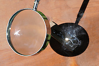 Magnifying Glass Concentrating Sunlight and Generating High Temperatures