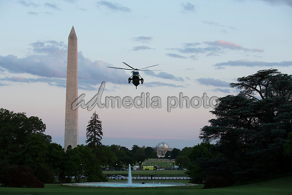"Marine One, carrying United States President Donald J. Trump, approaches the South Lawn of the White House in Washington, D.C., U.S., as he arrives from the Kennedy Space Center in Florida on Saturday, May 30, 2020.  Trump vowed his administration would end what he called ""mob violence"" in U.S. cities following the death of an unarmed black man at the hands of Minnesota police, blaming leftist groups for clashes with police and property damage around the nation. <br /> Credit: Stefani Reynolds / Pool via CNP/AdMedia"