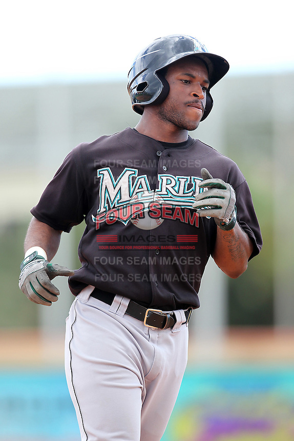 Outfielder Marquise Cooper of the Florida Marlins instructional League team rounds the bases after hitting a home run during a game against the Italian National Team at the Roger Dean Stadium in Jupiter, Florida;  September 27, 2011.  Italy is training in Florida for the Baseball World Cup.  (Mike Janes/Four Seam Images)