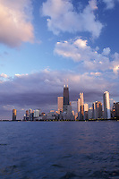 Chicago, Illinois, A view of the skyline of downtown Chicago from the waters of Lake Michigan at sunset.