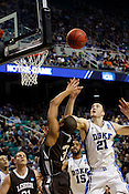 Miles Plumlee grabs a rebound in the second half. Lehigh defeated Duke 75-70 during the 2nd round of the 2012 NCAA Basketball Championship at the Greensboro Coliseum in Greensboro, NC. Photo by Al Drago.