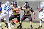 Palos Verdes, CA 09/13/13 - Mike Pettis (Peninsula #75) and Carlo Merola (Peninsula #60) in action during the Culver City vs Palos Verdes Peninsula High School Varsity Football game at Palos Verdes Peninsula HIgh School.