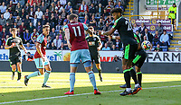 Burnley's Chris Wood scores the opening goal under pressure from Bournemouth's Tyrone Mings<br /> <br /> Photographer Alex Dodd/CameraSport<br /> <br /> The Premier League - Burnley v Bournemouth - Sunday 13th May 2018 - Turf Moor - Burnley<br /> <br /> World Copyright &copy; 2018 CameraSport. All rights reserved. 43 Linden Ave. Countesthorpe. Leicester. England. LE8 5PG - Tel: +44 (0) 116 277 4147 - admin@camerasport.com - www.camerasport.com