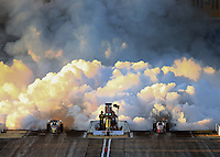 Feb 21, 2014; Chandler, AZ, USA; A pair of NHRA jet cars shoot smoke into the sky as they launch off the starting line during qualifying for the Carquest Auto Parts Nationals at Wild Horse Pass Motorsports Park. Mandatory Credit: Mark J. Rebilas-USA TODAY Sports