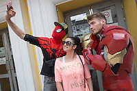 Hungarian fans dressed as their favourite movie characters celebrate the premiere of Captain America 3 in a movie theatre in downtown Budapest, Hungary on May 07, 2016. ATTILA VOLGYI