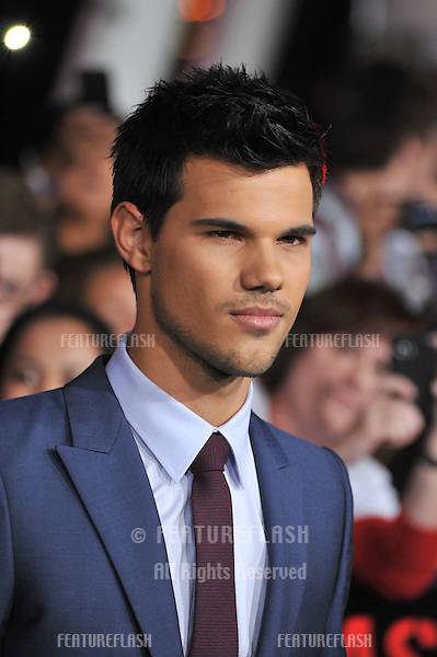 "Taylor Lautner at the world premiere of his new movie ""The Twilight Saga: Breaking Dawn - Part 1"" at the Nokia Theatre, L.A. Live in downtown Los Angeles..November 14, 2011  Los Angeles, CA.Picture: Paul Smith / Featureflash"