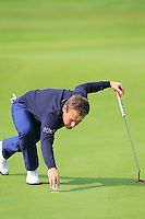 Tyrrell Hatton (ENG) retreives his ball from the cup on the 9th green during Sunday's Final Round of the 2014 BMW Masters held at Lake Malaren, Shanghai, China. 2nd November 2014.<br /> Picture: Eoin Clarke www.golffile.ie