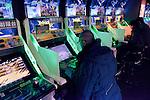 People playing Border Break video game arcade slot machines in Tokyo, Japan
