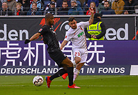 Marco Richter (FC Augsburg) gegen Almamy Touré (Eintracht Frankfurt) - 14.04.2019: Eintracht Frankfurt vs. FC Augsburg, Commerzbank Arena, 29. Spieltag DISCLAIMER: DFL regulations prohibit any use of photographs as image sequences and/or quasi-video.