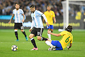 June 9th 2017, Melbourne Cricket Ground, Melbourne, Australia; International Football Friendly; Brazil versus Argentina; Ever Banega of Argentina jumps over Filipe Luis Kasmirski of Brazil