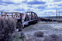 A pony truss bridge carries an alignment of the Lincoln Highway over the Blacks Fork River near Granger, Wyoming