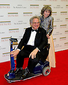 Itzhak Perlman, and his wife, Toby, arrive for the formal Artist's Dinner honoring the recipients of the 2012 Kennedy Center Honors hosted by United States Secretary of State Hillary Rodham Clinton at the U.S. Department of State in Washington, D.C. on Saturday, December 1, 2012. The 2012 honorees are Buddy Guy, actor Dustin Hoffman, late-night host David Letterman, dancer Natalia Makarova, and the British rock band Led Zeppelin (Robert Plant, Jimmy Page, and John Paul Jones)..Credit: Ron Sachs / CNP