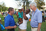 Kris Parker (C) adjusts a JCP&L Hard Hat on his son Cameron (23 months) while Lieutenant Josh Bard (L) of the Long Branch, NJ Police Department and Jim Markey (R) Area Manager for JCP&L look on at the National Night Out in Long Branch, New Jersey on Tuesday August 2, 2016.<br /> <br /> MODEL RELEASE SIGNED
