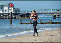 BNPS.co.uk (01202 558833)<br /> Pic: PhilYeomans/BNPS<br /> <br /> A jogger enjoys the glorious sunshine on Bmth beach.<br /> <br /> Holidaymakers make the most of the first hot weekend of the year on Bmthn beach today.