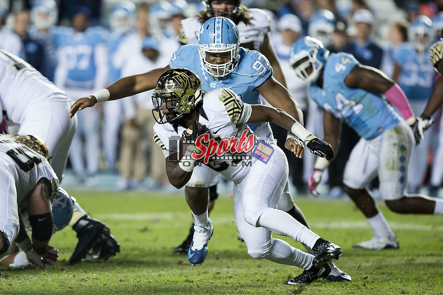 Jalen Dalton (97) of the North Carolina Tar Heels closes in on Isaiah Robinson (21) of the Wake Forest Demon Deacons during second half action at Keenan Stadium on October 17, 2015 in Chapel Hill, North Carolina.  The Tar Heels defeated the Demon Deacons 50-14.   (Brian Westerholt/Sports On Film)