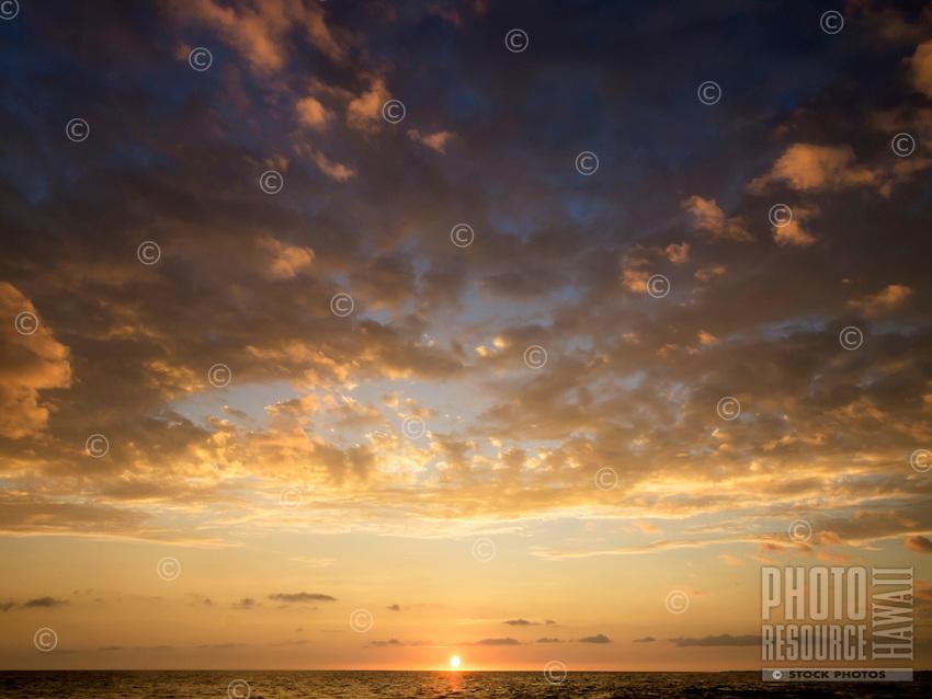 A warm glowing sunset off the coast of the Island of Hawai'i.