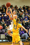 SIOUX FALLS, SD, FEBRUARY 10:  Sam Knecht #50 from the University of Sioux Falls lays the ball up against Paige Peterson #23 from Augustana Friday night at the Stewart Center in Sioux Falls. (Photo by Dave Eggen/Inertia)