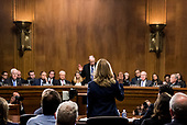 UNITED STATES - SEPTEMBER 27: Dr. Christine Blasey Ford is sworn in by chairman Chuck Grassley, R-Iowa, on Thursday, Sept. 27, 2018, during the Senate Judiciary Committee hearing on the nomination of Brett M. Kavanaugh to be an associate justice of the Supreme Court of the United States, focusing on allegations of sexual assault by Kavanaugh against Christine Blasey Ford in the early 1980s. (Photo By Tom Williams/CQ Roll Call/POOL)