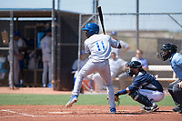 AZL Royals left fielder David Hollie (11) at bat in front of catcher Rainier Aguilar (8) and home plate umpire Alan Gorewitz during an Arizona League game against the AZL Padres 1 at Peoria Sports Complex on July 4, 2018 in Peoria, Arizona. The AZL Royals defeated the AZL Padres 1 5-4. (Zachary Lucy/Four Seam Images)