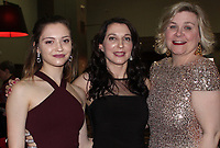 NWA Democrat-Gazette/CARIN SCHOPPMEYER Aubrey Hill (from left), Jonni Tuttle and Regan Eaton visit at the masquerade benefit Feb. 23 in Bentonville. Tuttle, a former Havenwood resident, was the keynote speaker.