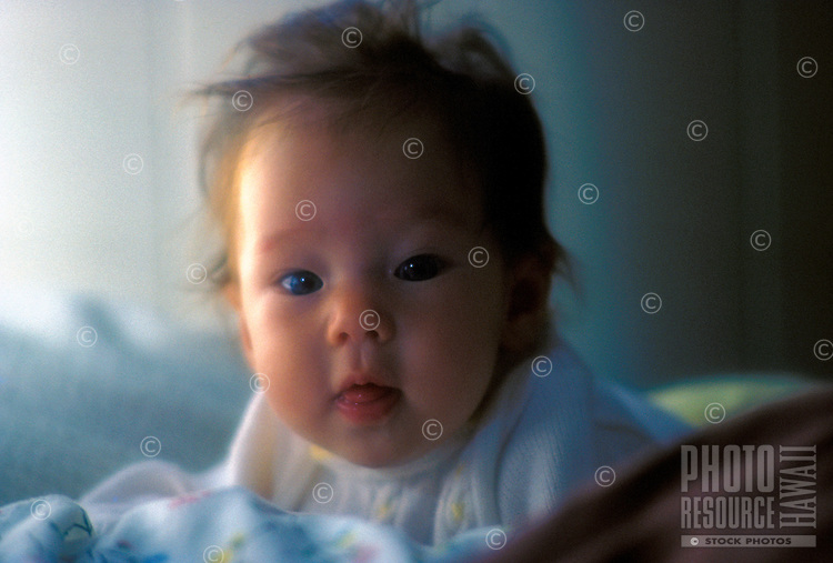 Head shot of a cute six month old Japanese/Caucasian baby.