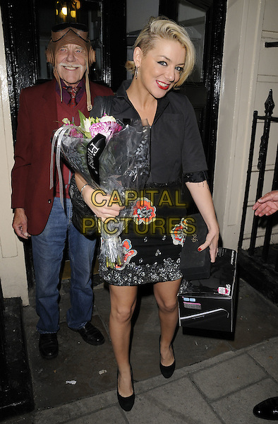 """Sheridan Smith.Departing after the final performance of """"Flare Path"""", Theatre Royal, London, England..June 11th, 2011.full length grey gray jacket dress black red floral print smiling flowers bouquet ghd box.CAP/CAN.©Can Nguyen/Capital Pictures."""