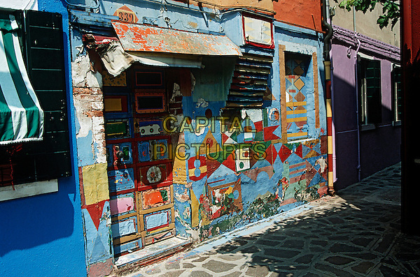 Colourful multi coloured painted wall of building, Burano, Venice, Italy