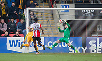 Scott Brown of Cheltenham Town makes a save during the Sky Bet League 2 match between Cheltenham Town and Cambridge United at the LCI Stadium, Cheltenham, England on 18 March 2017. Photo by Mark  Hawkins / PRiME Media Images.