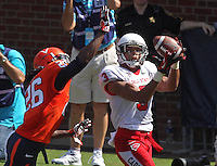 Ball State wide receiver Willie Snead (3) makes a touchdown catch in front of Virginia cornerback Maurice Canady (26) during the football game Saturday Oct. 5, 2013 at Scott Stadium in Charlottesville, VA. Ball State defeated Virginia 48-27. Photo/The Daily Progress/Andrew Shurtleff
