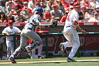 05/06/12 Anaheim, CA: Toronto Blue Jays catcher J.P. Arencibia #9 and Los Angeles Angels Mark Trumbo #44 during an MLB game against the Toronto Blue Jays played at Angel stadium. The Angels defeated the Blue Jays 4-3