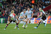 Dan Lydiate of Racing Metro 92 challenges Matt Hopper (left) and Mike Brown of Harlequins during the Heineken Cup match between Harlequins and Racing Metro 92 at the Twickenham Stoop on Sunday 15th December 2013 (Photo by Rob Munro)