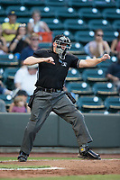 Home plate umpire Andy Stukel calls a batter out on strikes during the Carolina League game between the Buies Creek Astros and the Winston-Salem Dash at BB&T Ballpark on June 23, 2017 in Winston-Salem, North Carolina.  The Astros defeated the Dash 3-0.  (Brian Westerholt/Four Seam Images)