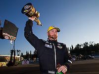Feb 8, 2015; Pomona, CA, USA; NHRA top fuel driver Shawn Langdon celebrates after winning the Winternationals at Auto Club Raceway at Pomona. Mandatory Credit: Mark J. Rebilas-USA TODAY Sports