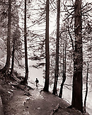 USA, California, Yosemite National Park, a woman hikes the trail down from Vernal Falls (B&W)