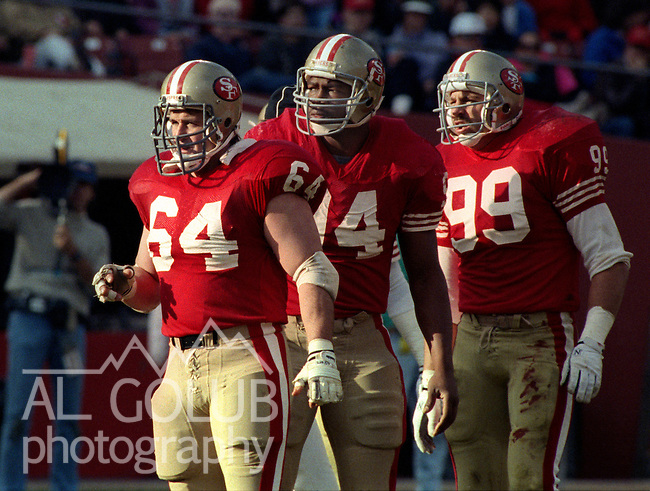 San Francisco 49ers vs Buffalo Bills at Candlestick Park Sunday, December 17, 1989..49ers beat Bills 21-10.49ers tackle Jim Burt (64), defensive end Charles Haley (94) and defensive end Mike Walters (99)..