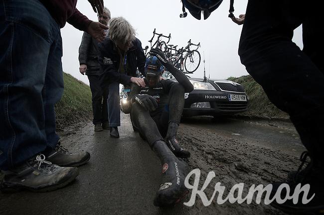 Dwars Door Vlaanderen 2013.Jack Bauer (NZL) stays down after crashing hard on the Ladeuze descent